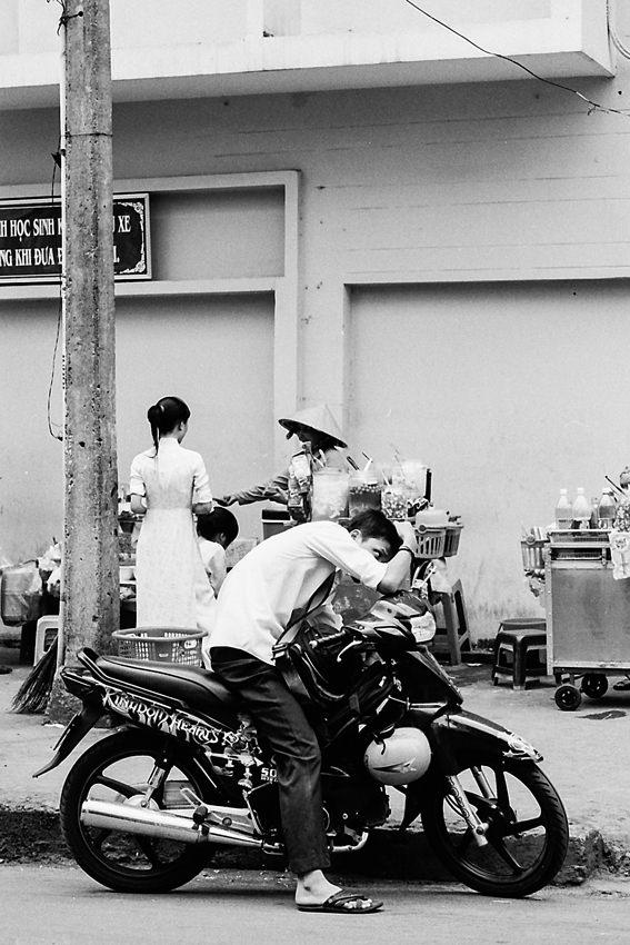 Careful dresser on the motorbike