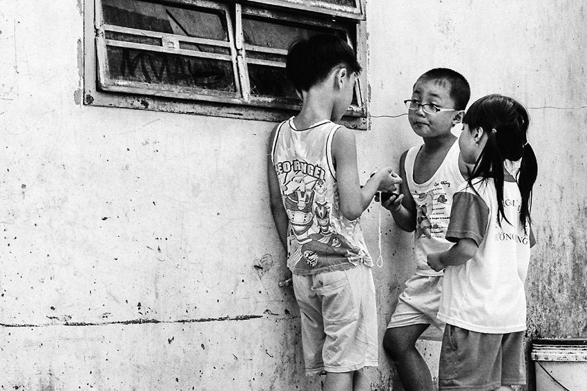 Three kids standing talking