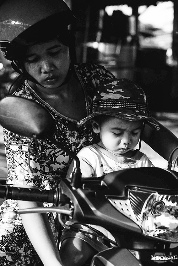 Mother and son on motorbike