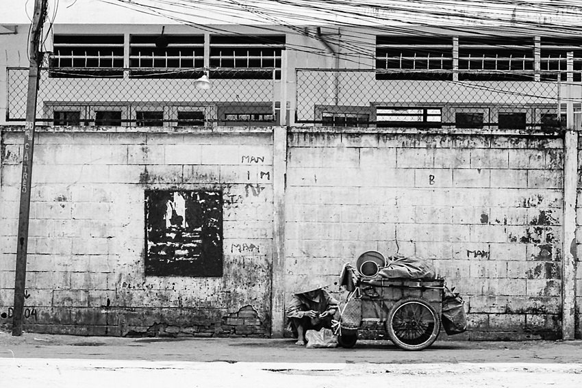 Two-wheeled cart in front of wall