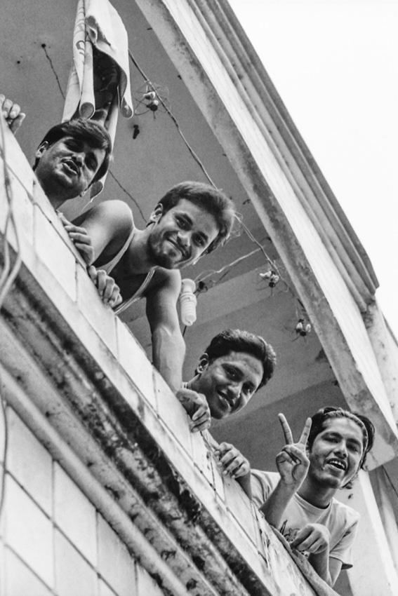 Men looking down from veranda