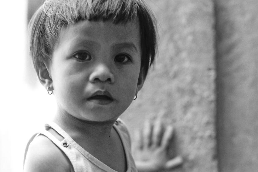 Little kid wearing pierced earring