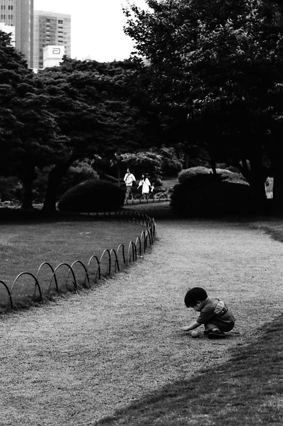 Boy playing in path in Shinjuku Gyoen