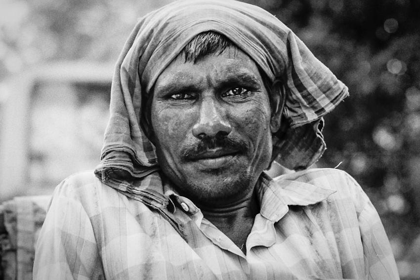 Rickshaw wallah with a glum look