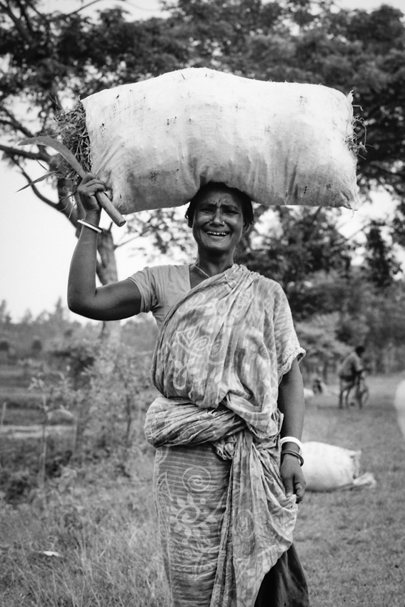 Woman putting big bag on head