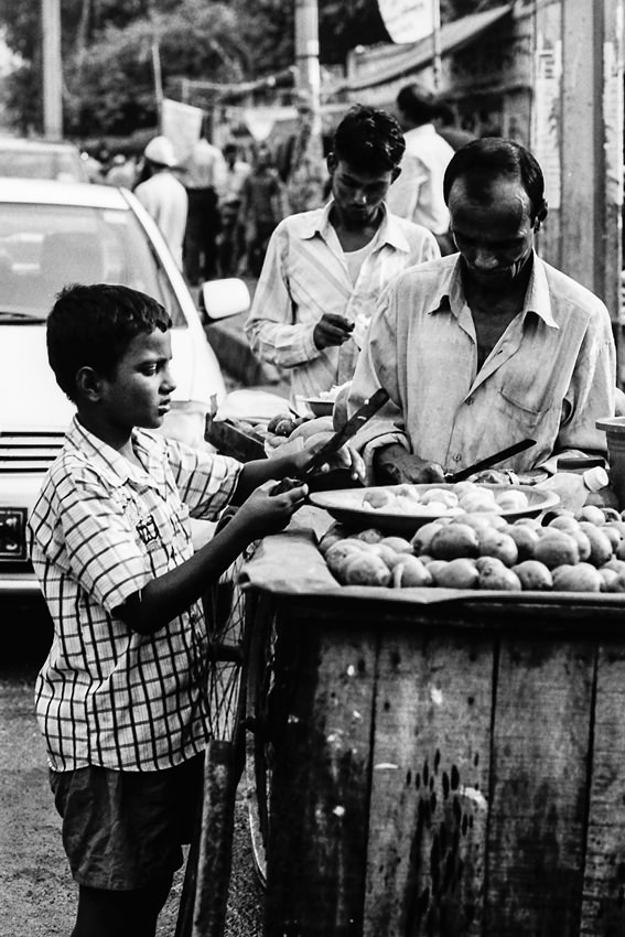 Men selling fruits by roadside