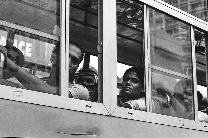 Opened windows of running bus