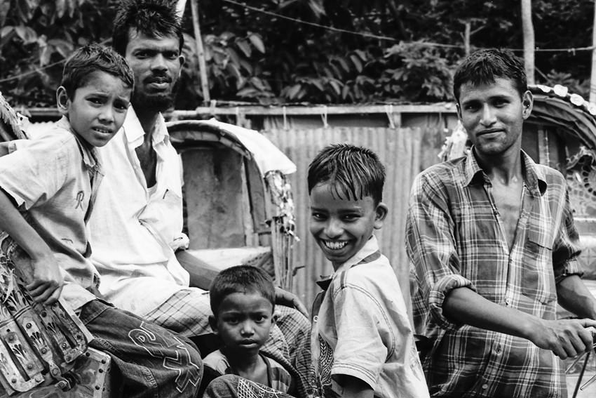 Men and boys around cycle rickshaw