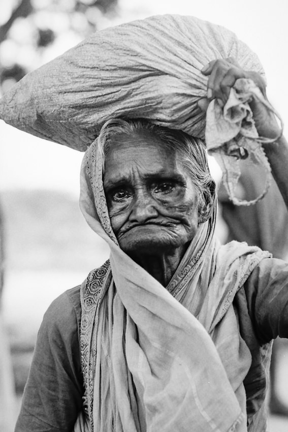 Older woman carrying bag