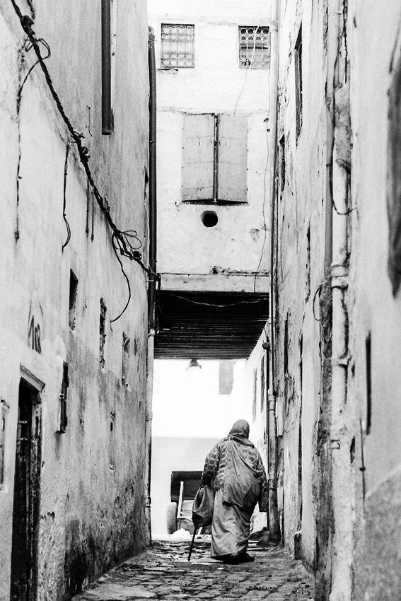 Older woman walking the lane