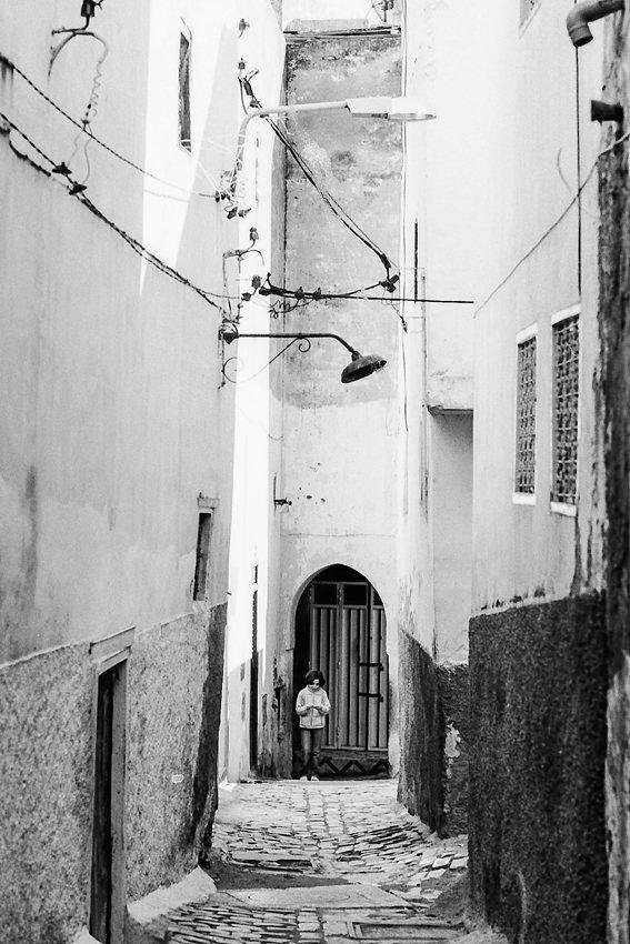 Girl walking the deserted lane