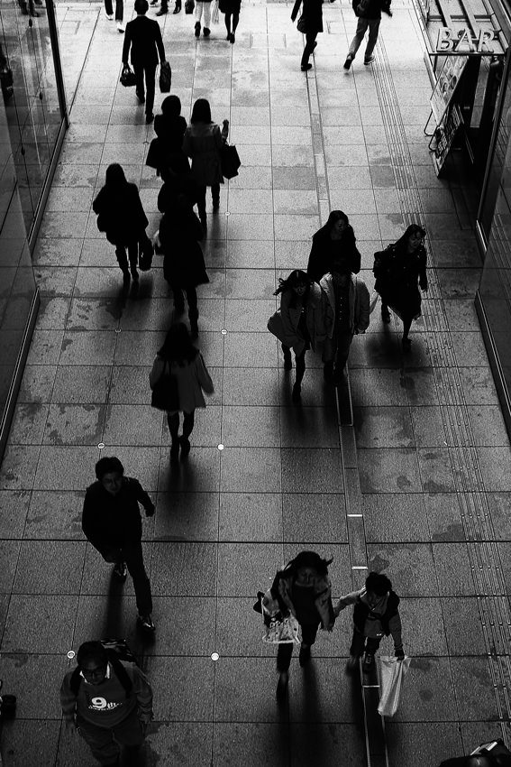 Silhouettes of shoppers
