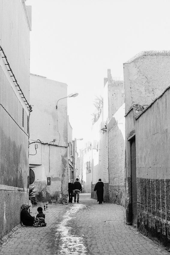 Figures in serene alleyway in Marrakesh