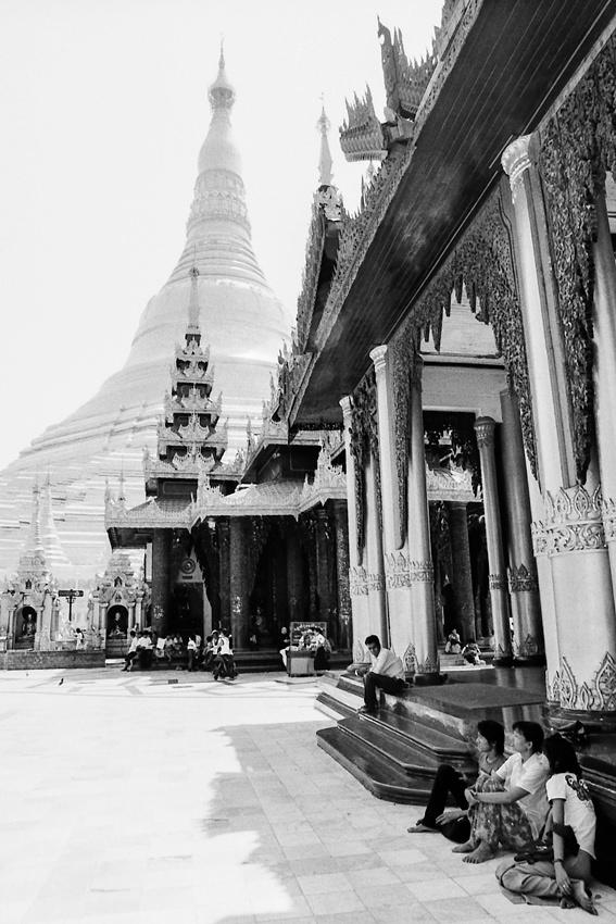 People resting near pagoda in Shwedagon Paya