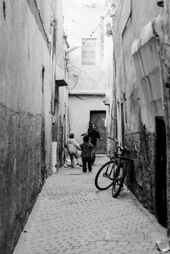 Kids playing in lane in old quarter
