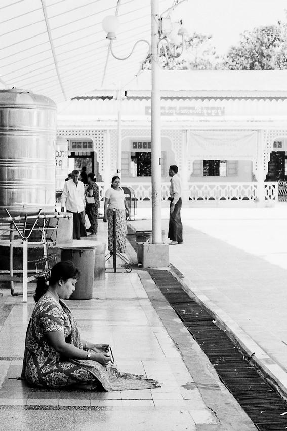 Woman praying under eaves