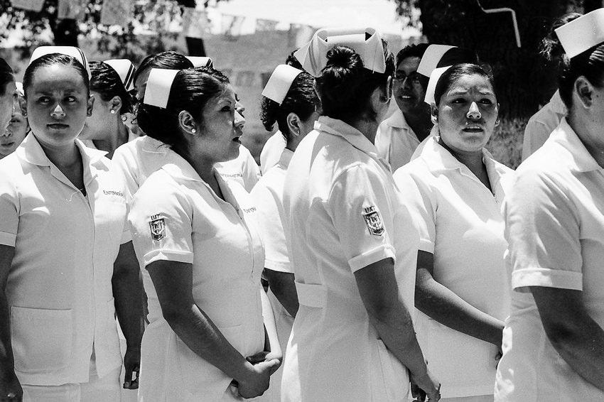 Nurses wearing a nurse's cap