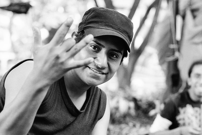 Young man bending middle finger