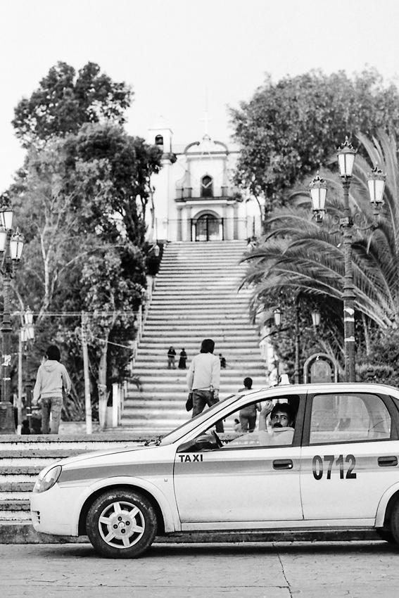 Taxi stopping at bottom of stairway