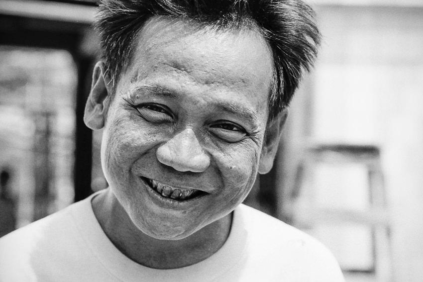 Man smiling weakly
