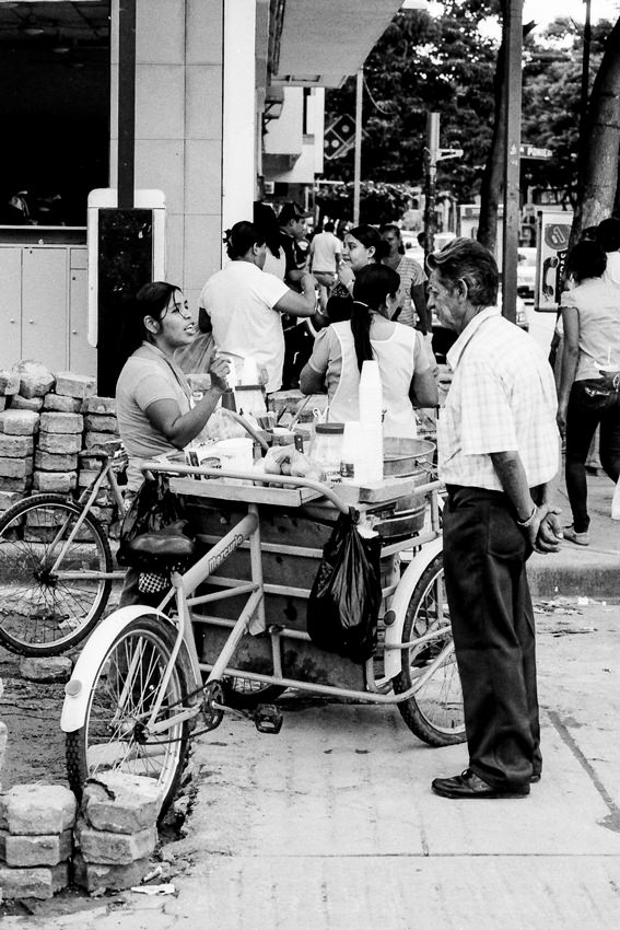 Man in front of food stall