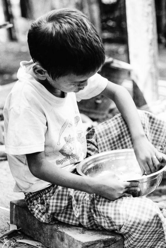 Boy holding bowl