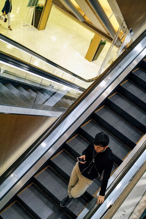 Young man on escalator