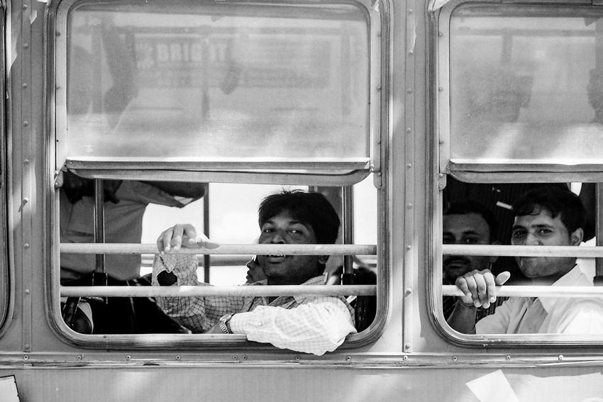 Passenger smiling in bus