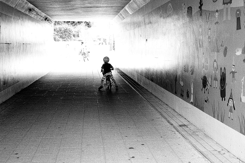 Little boy in tunnel