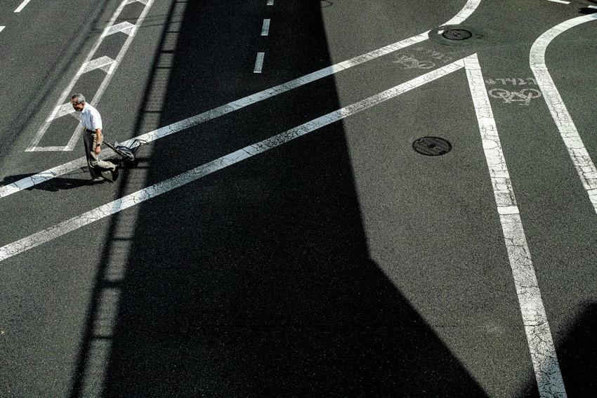 man dragging roller bag