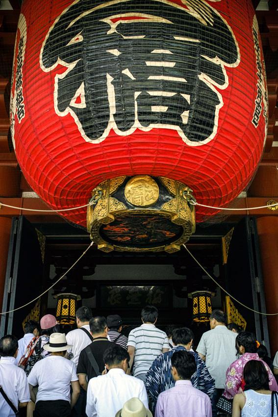 worshipers under big lantern