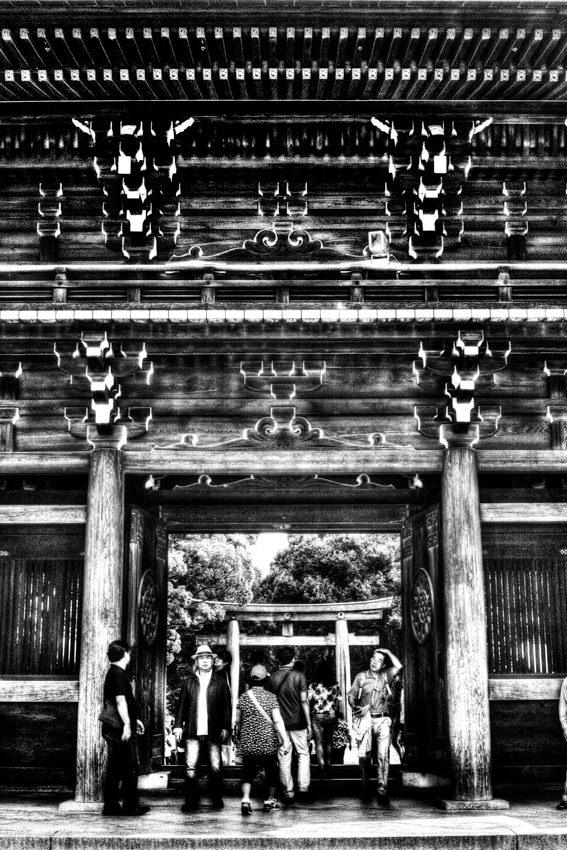 Worshipers passing through gate