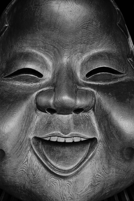 Wooden mask smiling