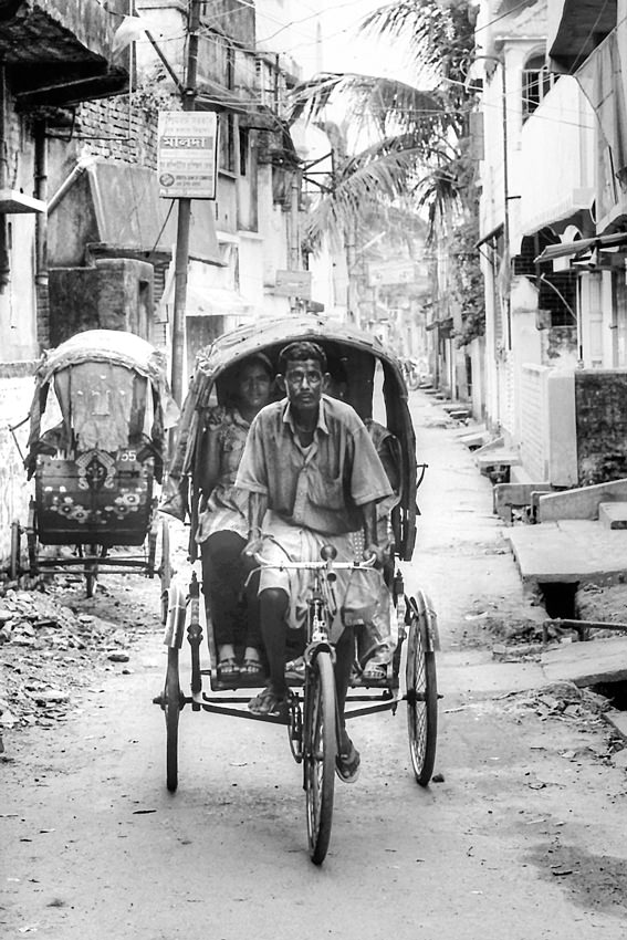 Cycle rickshaw running dirt road