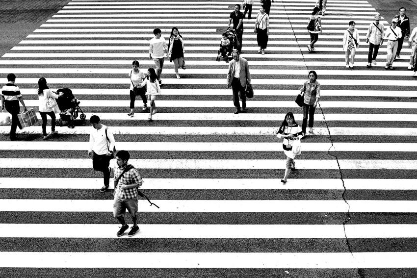Pedestrians crossing wide street