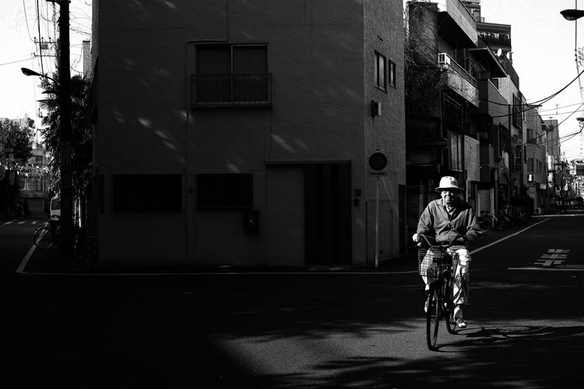 Old man riding bicycle