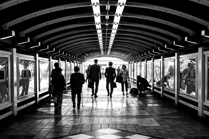 Pedestrians walking under railway underpass