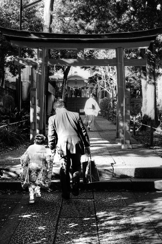 black-tied family in Shinto shrine