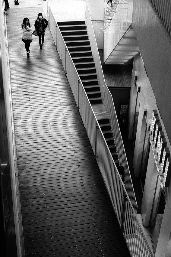 Two girls walking on passage