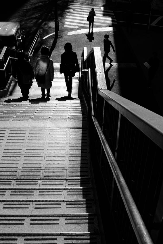 Silhouettes around pedestrian bridge