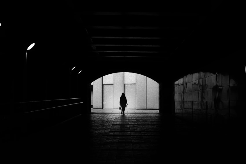 Silhouette at end of tunnel