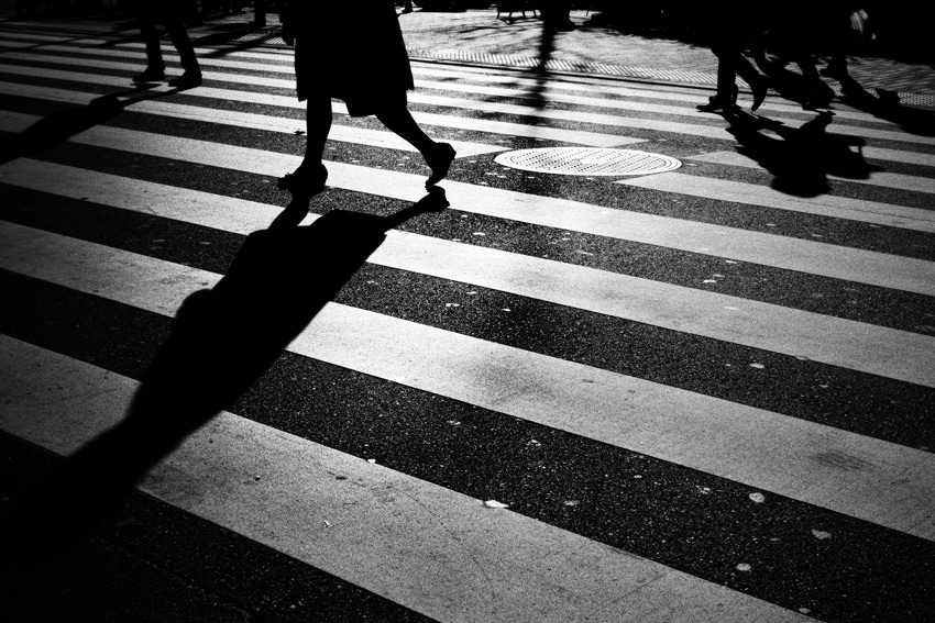 Silhouettes on pedestrian crossing
