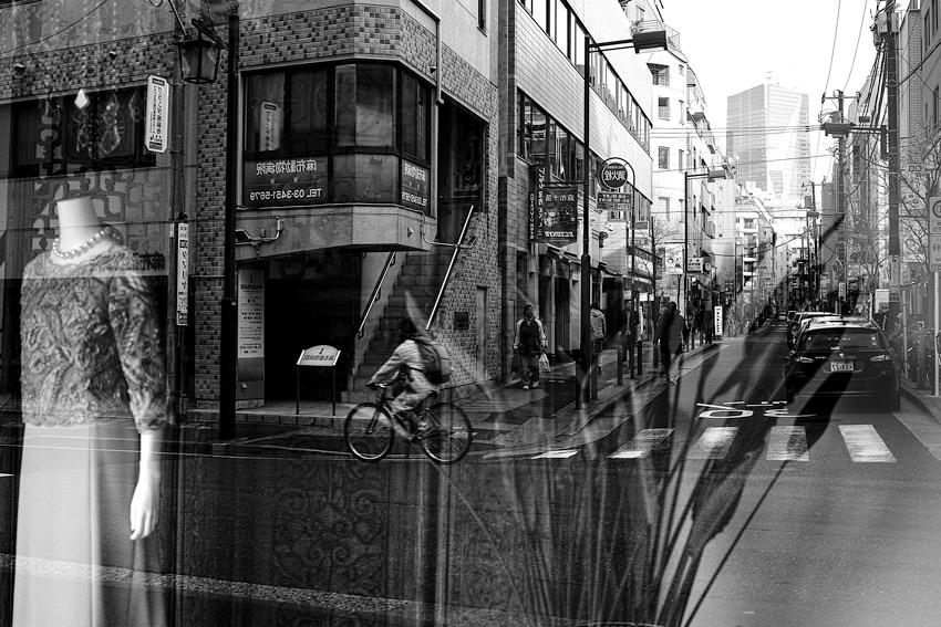Street reflected on glass window
