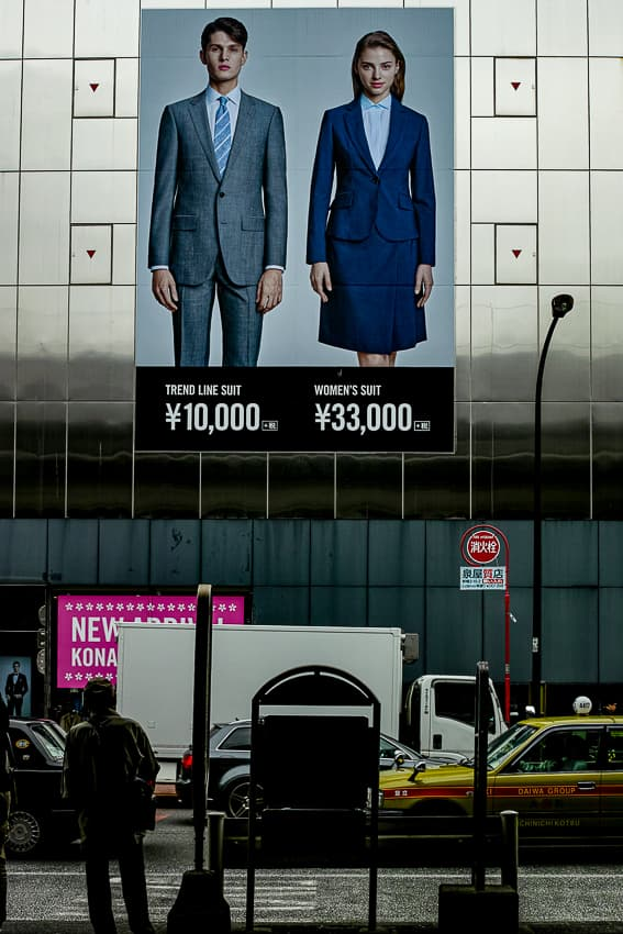 Young man and woman in a poster on wall