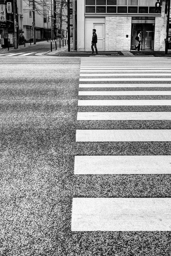 Figure on opposite side of street