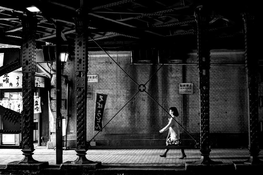 woman walking railway underpass