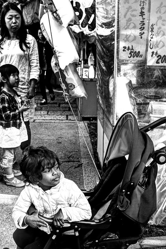 little girl on baby buggy
