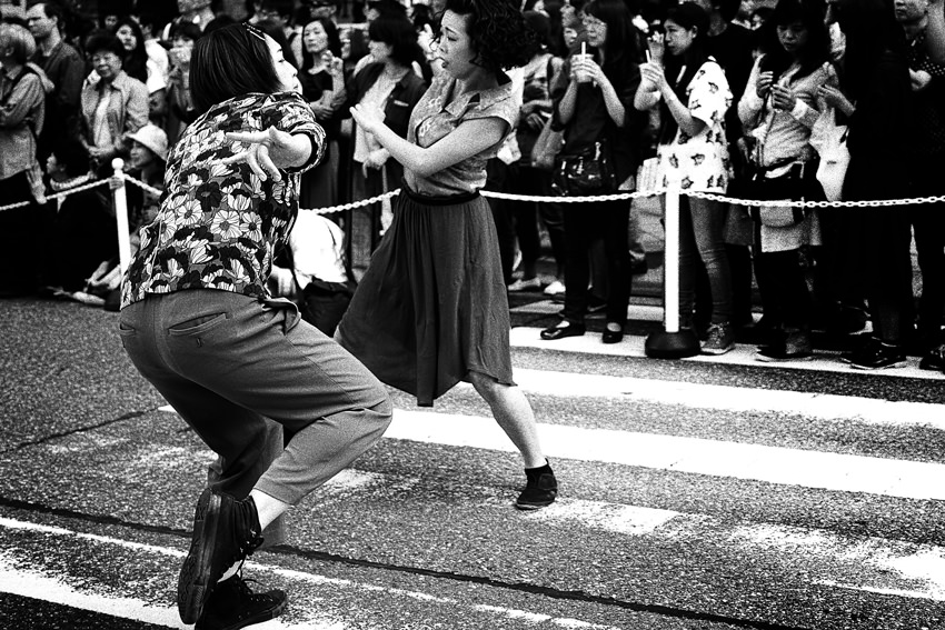 Women dancing in street