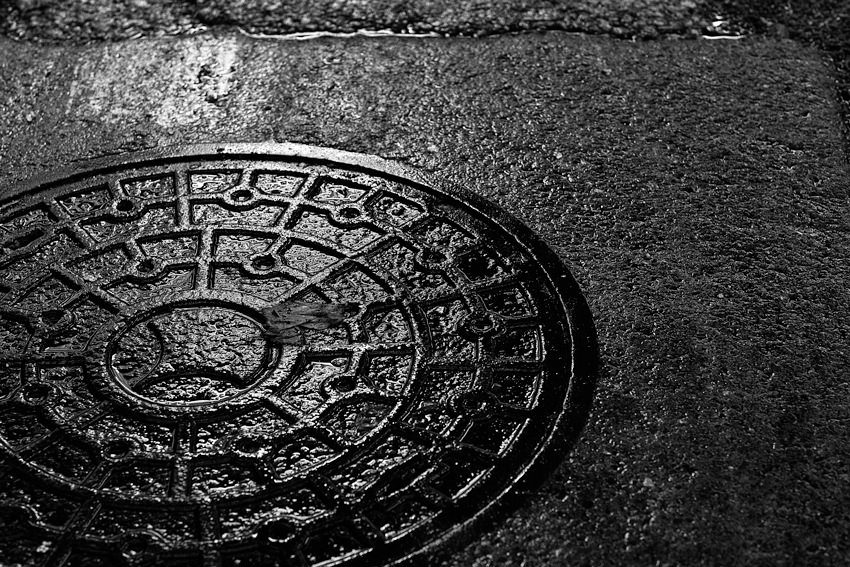 Manhole on wet ground