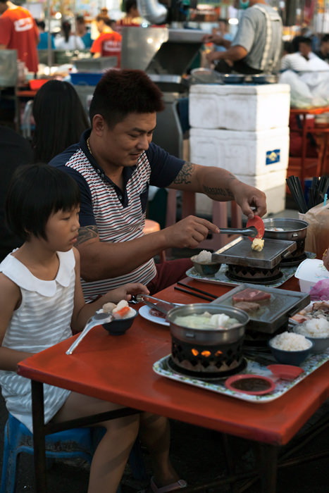 Father And His Daughter In The Night Market (Taiwan)
